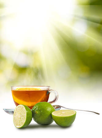 image of cups with tea and lemon on sunlight background closeup Stock Photo
