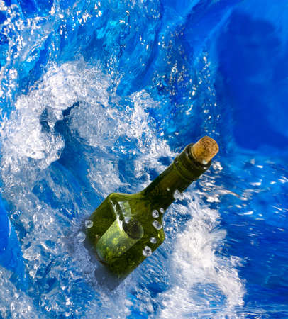 bottle with letter in sea water close up. Stock Photo