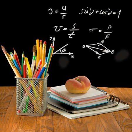 food supply: Image of pencils, notebooks, peach and student board
