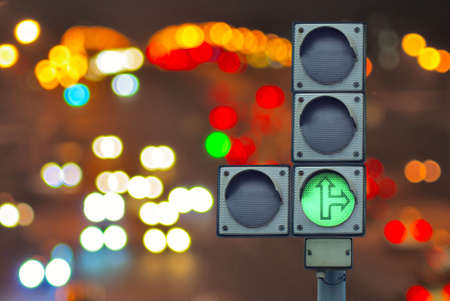 stop and go light: image of traffic light on lights background,