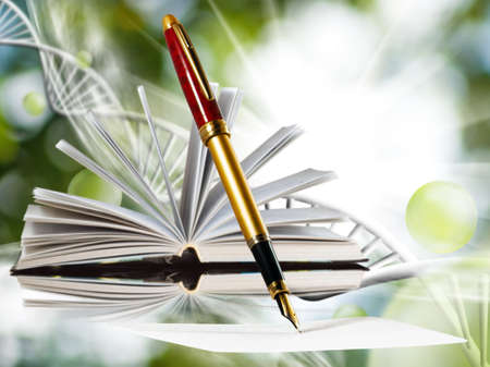 Image of book and pens on abstract background