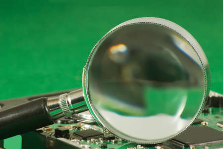 enlargement: Image of magnifier on microchip background