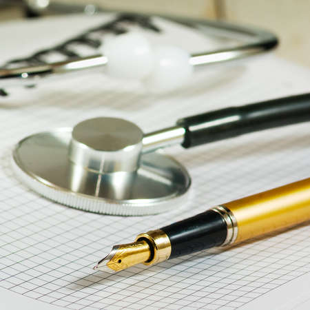 tonometer: image of stethoscope, notebooks and pen on white background