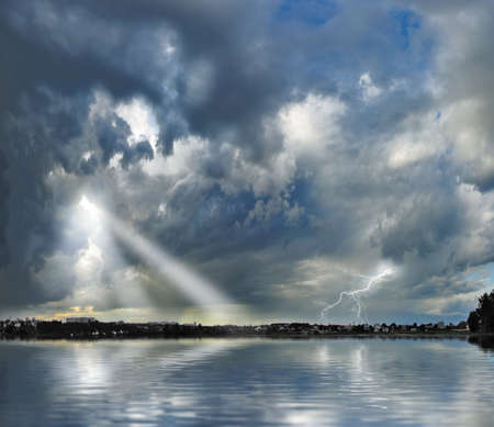 Image of a thunderstorm over the river Stock Photo