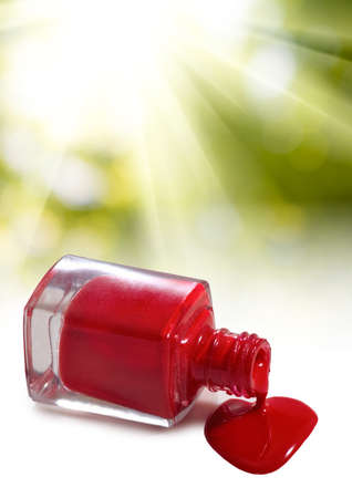 isolated image of red nail polish and heart on a white background Stock Photo
