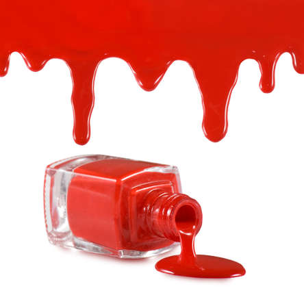 isolated image of red nail polish and heart on red background Stock Photo