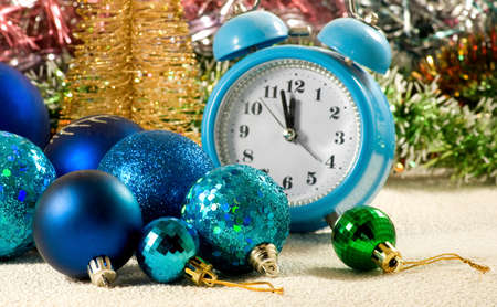 image of christmas decorations, alarm clock and stylized christmas tree
