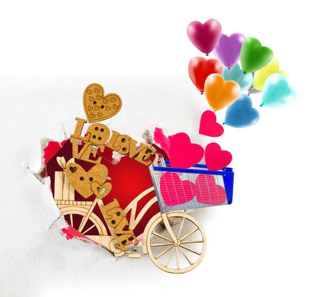 Image of a stylized wooden man, a bicycle and balloons in the garden.Symbolizes celebration and love.