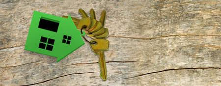 miniature house and keys on a wooden board Stock Photo