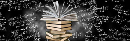 image of many books on board with formulas background close-up