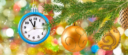 Image of beautiful festive designer christmas decorations. Christmas toys on the Christmas tree in the form of a clock Banco de Imagens