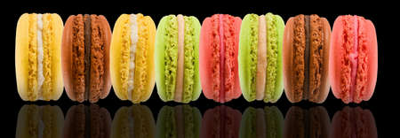 sweet and colorful dessert macarons isolated on black  background