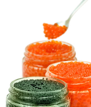 isolated image of three jars red and black caviar on a white background 스톡 콘텐츠