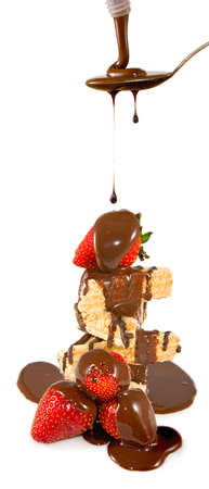 Isolated image of ripe strawberries in chocolate on a white background closeup