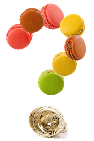 macarons laid out in the form of a question mark on a white background 写真素材