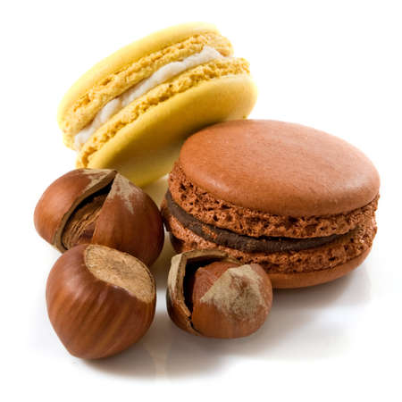 image of macarons and hazelnuts on a white background closeup Stockfoto