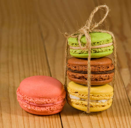 macarons lie on a wooden surface