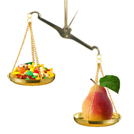 on the scales lies a pear that outweighs a bunch of drugs