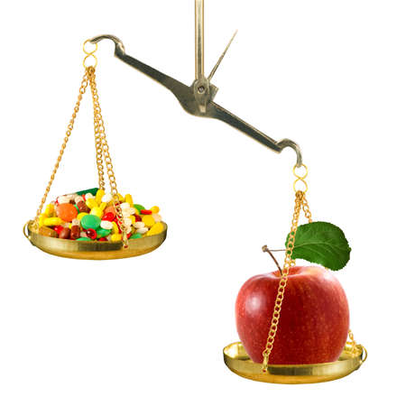on the scales lies an apple that outweighs a bunch of drugs