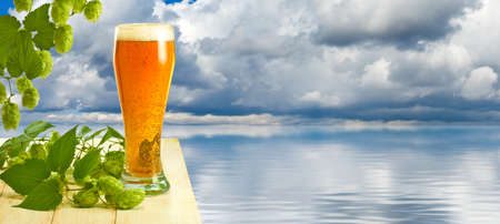 image of beer and hops on a background of a sea landscape