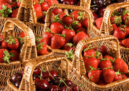 image of baskets filled with ripe cherries and strawberries