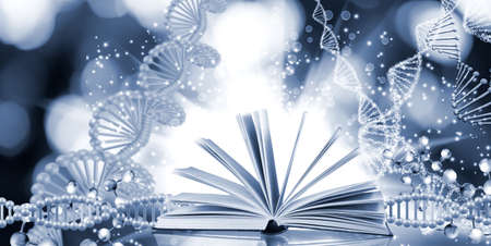 image of open book on  DNA genetic chain background Stock Photo