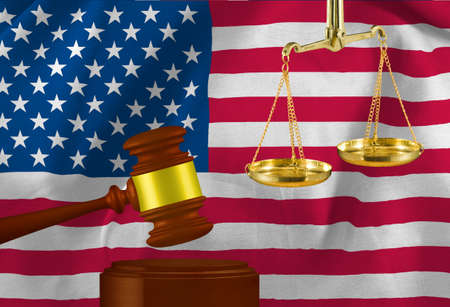 The image of the judges gavel and scales against the background of the flag of USA