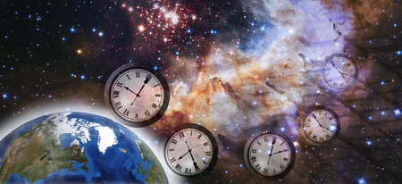 Clock flying in space against the background of the planet Earth and the beautiful starry sky. Stock Photo