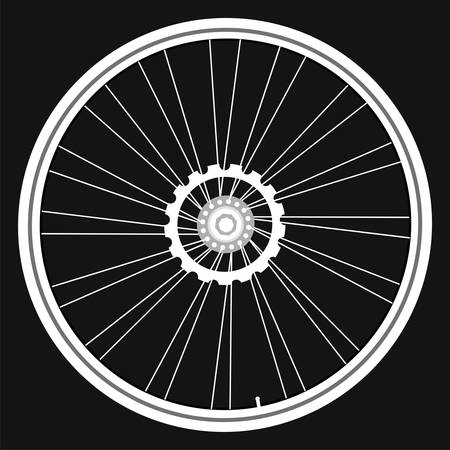 bicycle gear: white Bicycle wheels isolated on black background