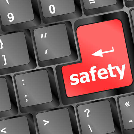 safety at work: safety first concept with red key on computer keyboard Stock Photo