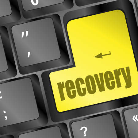 data recovery: key with recovery text on laptop keyboard