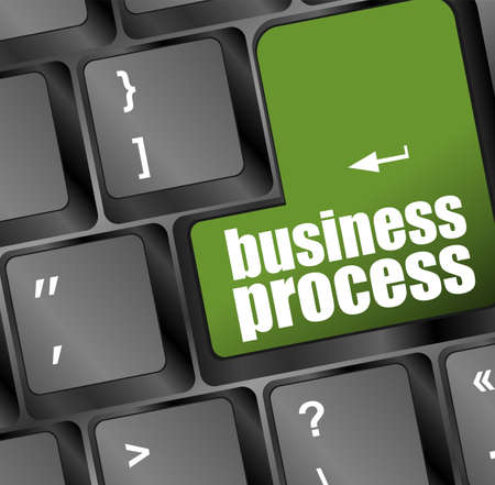 keyboard with green business process button photo