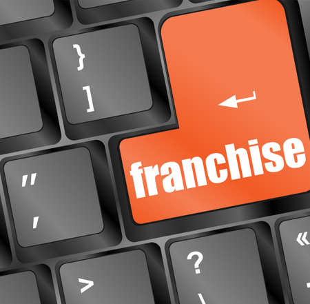 franchise: A keyboard with a key reading franchise - business concept