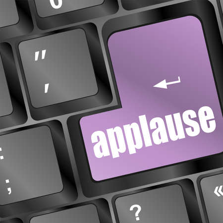 dissatisfaction: Computer keyboard with applause key - business concept