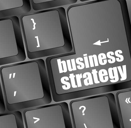 business strategy - business concepts on computer keyboard photo