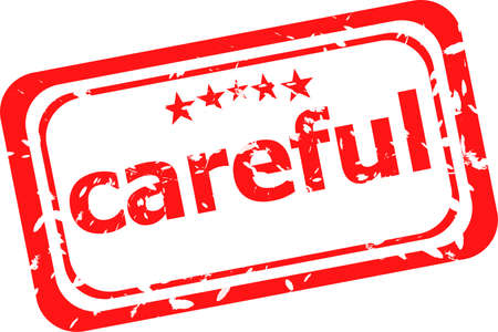 symbol vigilance: word careful on red rubber stamp Stock Photo