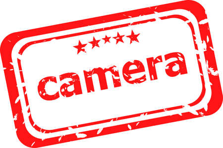camera on red rubber stamp over a white background photo