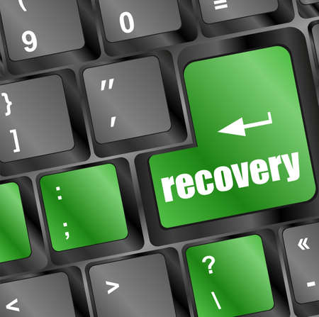 key with recovery text on laptop keyboard button photo