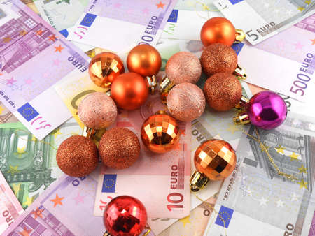 currency glitter: euro notes with christmas balls on it Stock Photo