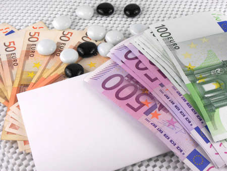 500 euros currency, white empty paper and stones photo