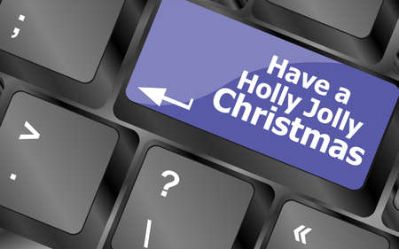 Computer keyboard key with have a holly jolly christmas words photo