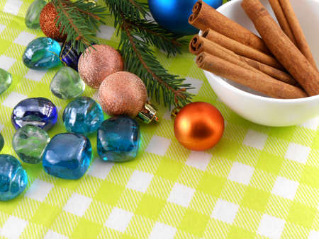 christmas decoration cinnamon baubles stones in yellow macro closeup photo