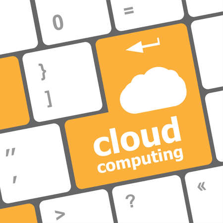 Cloud computing concept showing cloud icon on computer key photo