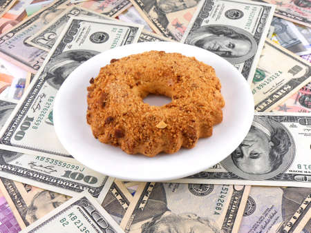 cake on money dollars background photo
