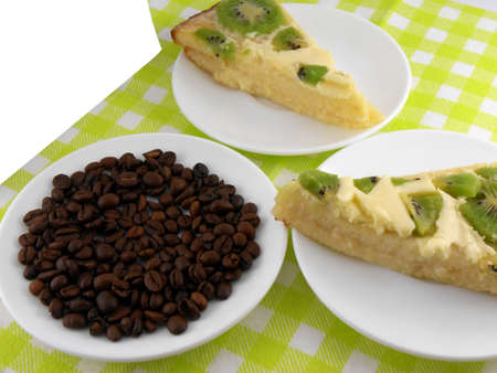 kiwi cake on white plate with coffee beans photo