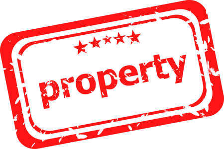 property on red rubber stamp over a white background photo