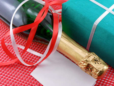 Bottle of a champagne and green gift boxes photo