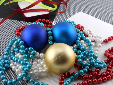 christmas ball and pearls on a plate, new year holiday card photo