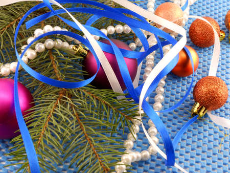 holiday concept: gifts, pearls, tree branch and christmas ball photo