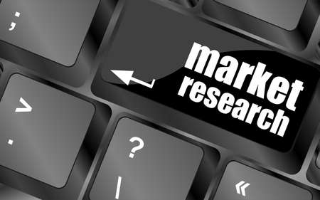 key with market research text on laptop keyboard, business concept photo